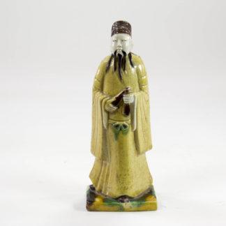 Figur, China, 16./17. Jh., Susancai, in gelb, grün und aubergine, Gebrauchsspuren. H: 13 cm, www.beyreuther.de