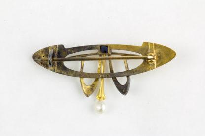 Brosche, Jugendstil, um 1910, 585er Gold, besetzt mit einem Saphir und einer kleinen Perle. L: 40 mm.