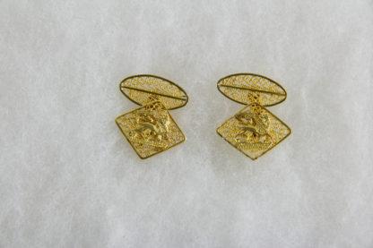 Paar Manschettenknöpfe, Äthiopien, Anf. 20. Jh., 18 Karat Gold, 8,8 g, verziert mit dem Wappen von Äthiopien, Geschenk von Kaiser Haile Selassie, feine Filigranarbeit. 2 cm x 2 cm, www.beyreuther.de