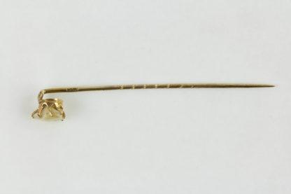 Krawattenadel, Anf. 20. Jh., 585er Gold gestempelt, gefasster Kinderzahn, guter gebrauchter Zustand. L: 5,5 cm