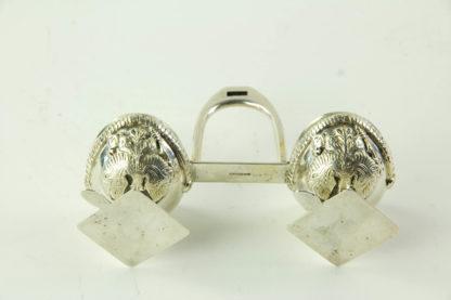 Salière, um 1900, 800er Silber gestempelt, in Form von zwei Ulanen Tschapkas, mit Steigbügel verbunden, innen vergoldet, ausgefallen, B: 11 cm, H: 7,5 cm.